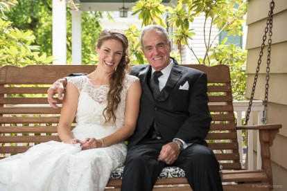 Bride with father on porch swing by Sorrells Photography