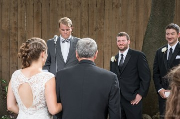 first look down the aisle at a backyard wedding