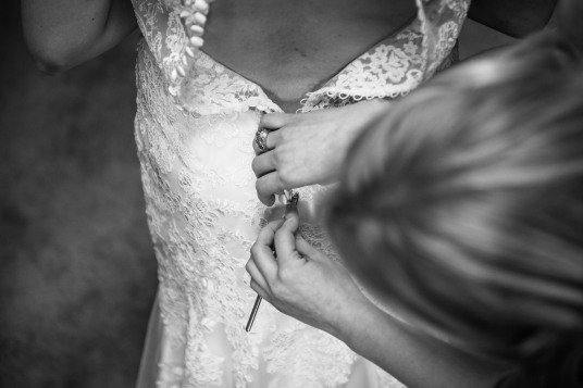 Buttoning up wedding dress