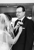 Bride helping father with boutonniere by Sorrells Photography
