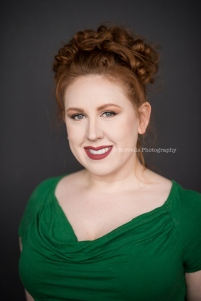 Redhead in green shirt, natural light portrait